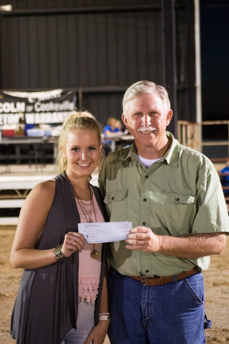 UCWHA President Jimmy Sherrell presents scholarship check for $500.00 to Alexis Clark.